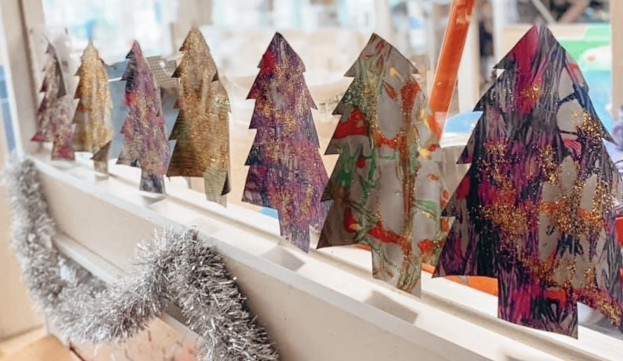 recycled paper christmas trees on window sill
